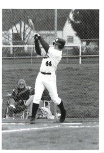 Bruins baseball player, number 44, swinging a bat.