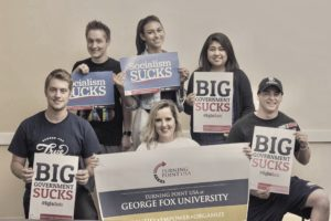 """Turning Point USA at George Fox University: Identify, Empower, Organize. 6 Students with signs. """"Big Government SUCKS"""" """"Socialism SUCKS"""" """"Turning Point USA"""""""