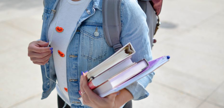 Student Carrying Textbook